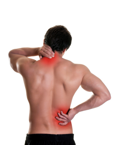 537234318 istock photo A man puts his hands on red spots on his back 184837323
