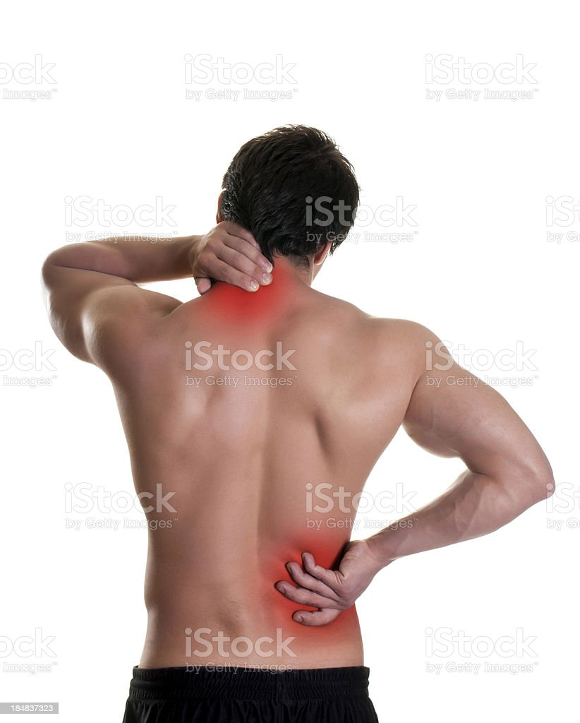 A man puts his hands on red spots on his back stock photo