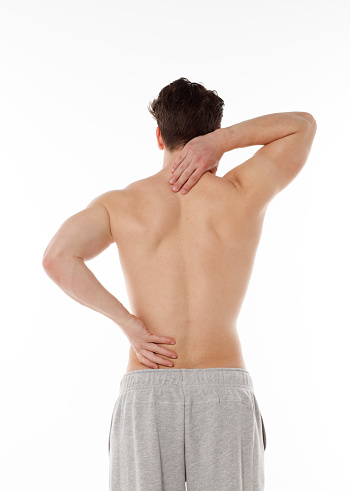 537234318 istock photo man puts his hands on red spots on his back 528571126