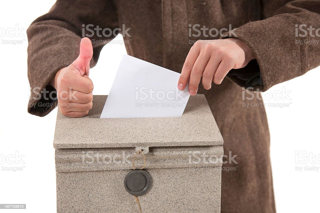 Man putting letter in mailbox,showing thumbs up gesture stock photo