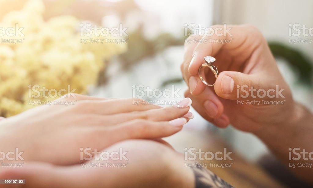 Man Putting On Girl Finger Engagement Ring Stock Photo More
