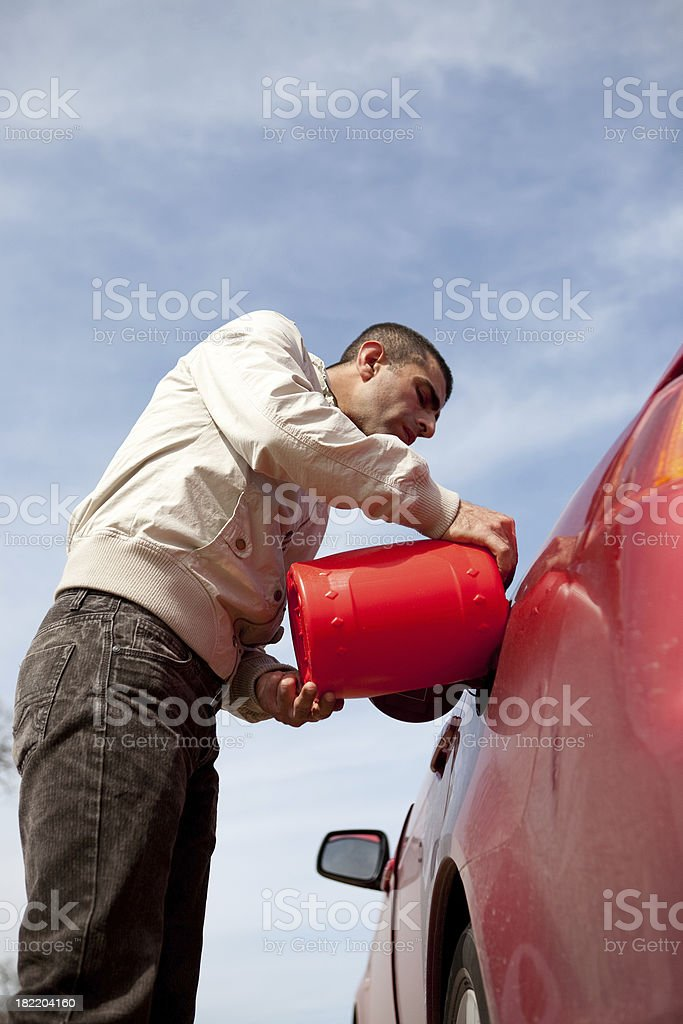Man putting petrol in car royalty-free stock photo