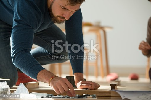 istock Man Putting Together Self Assembly Furniture 626176328