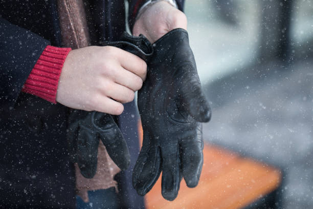 Man putting winter gloves on stock photo