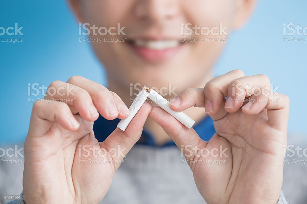 man quit smoking man quit smoking with blue background, asian Addiction Stock Photo
