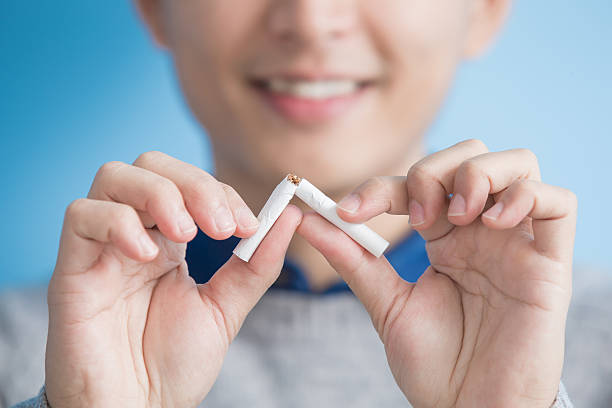 man quit smoking man quit smoking with blue background, asian arrestment stock pictures, royalty-free photos & images