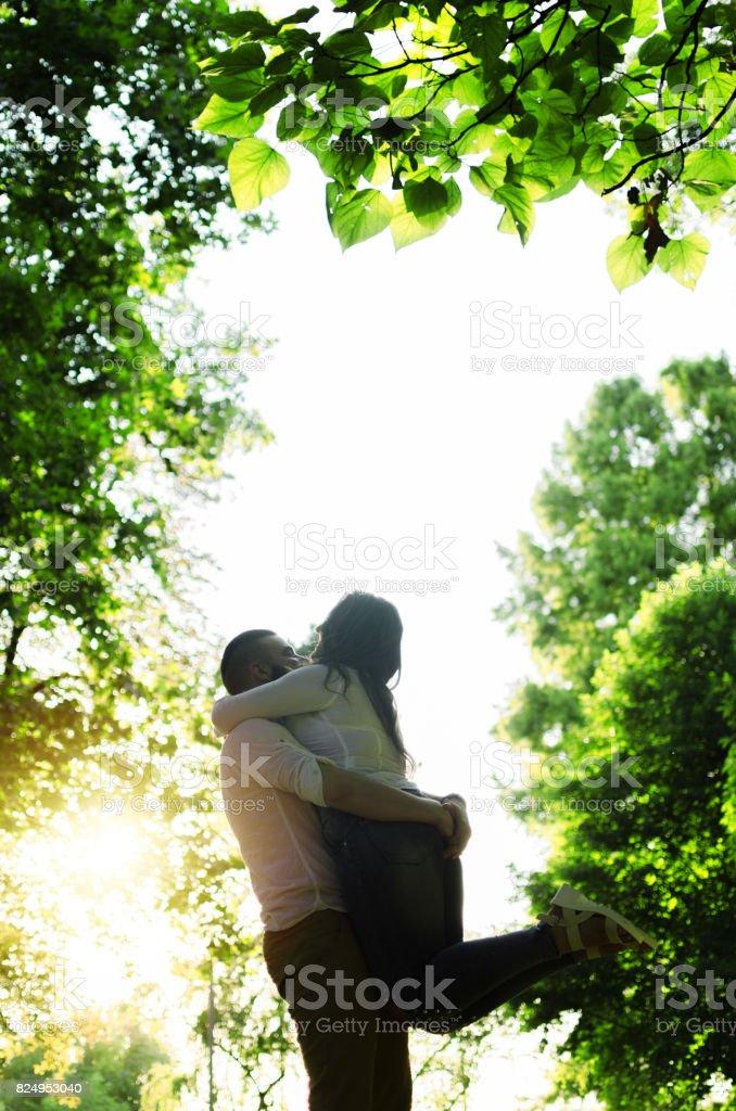 man raises his woman and having fun stock photo