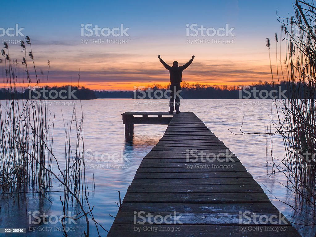 Man raising arms stock photo