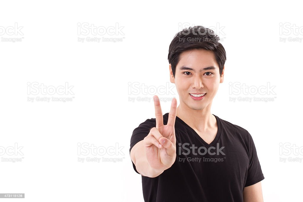 man raising, showing 2 finger, victory hand sign stock photo