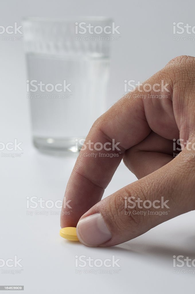 Man reaching for medication royalty-free stock photo