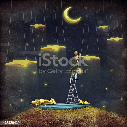istock Man reaching for stars  at top of tall ladder 478539432