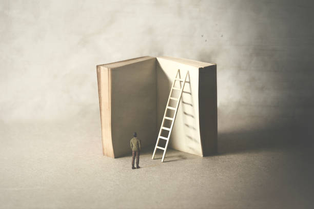 man reaching higher knowledge level, climbing a book, surreal concept stock photo