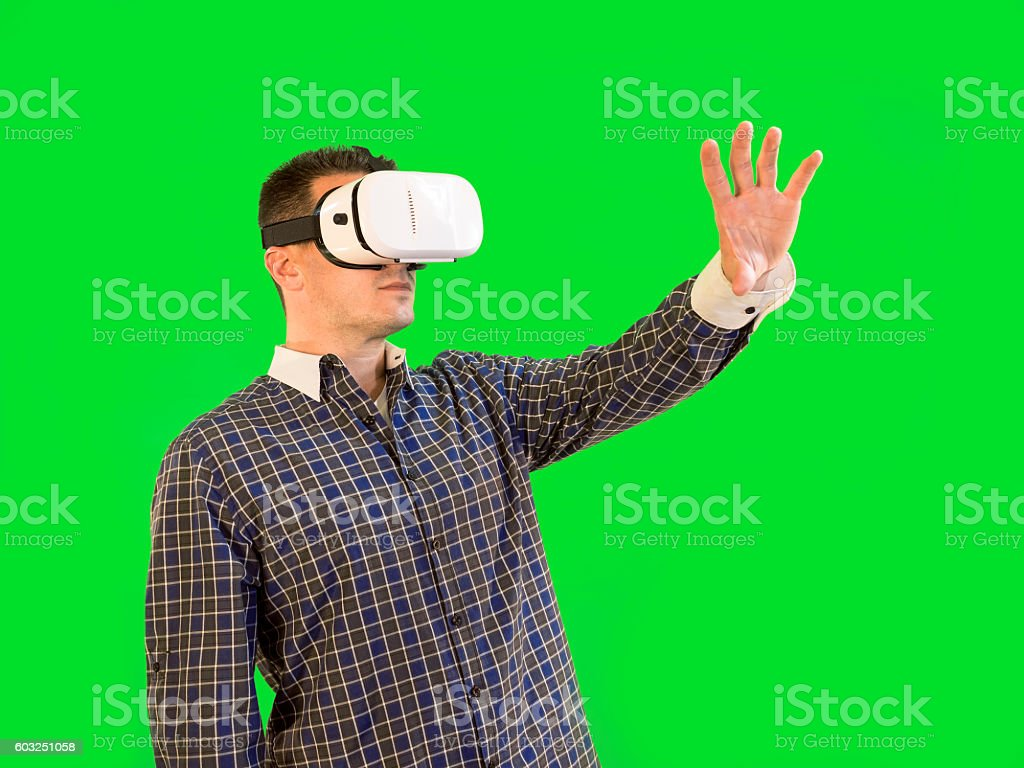 Man Reaching Out with Virtual Reality Goggles Green Screen stock photo