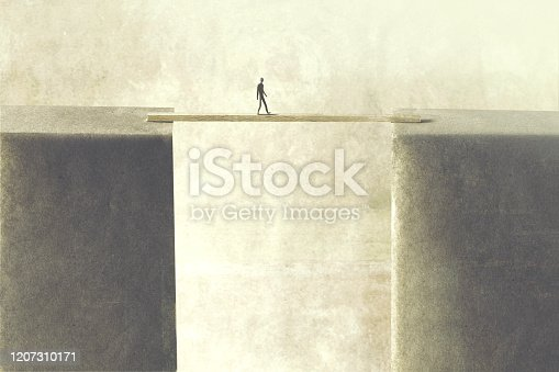 man walking on a tiny bridge