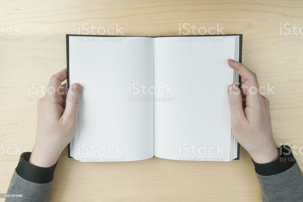 Man reading a blank book stock photo