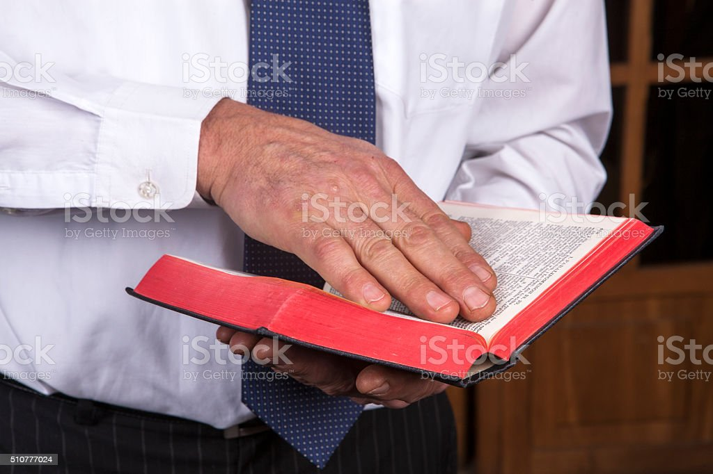 Man Reading A Book of Knowledge stock photo