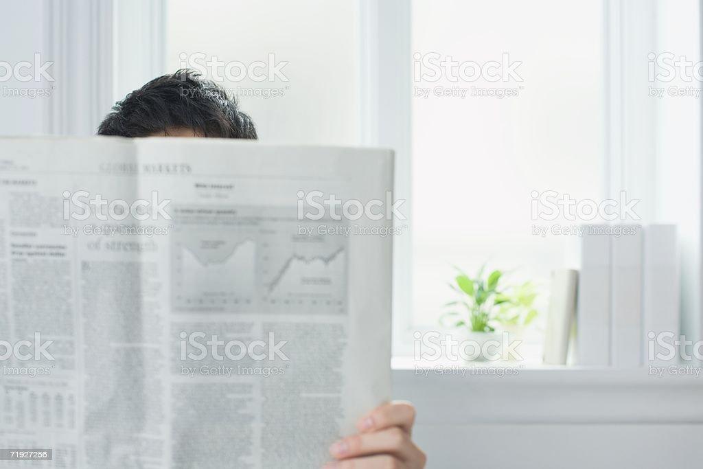 Man reading a broadsheet newspaper royalty-free stock photo
