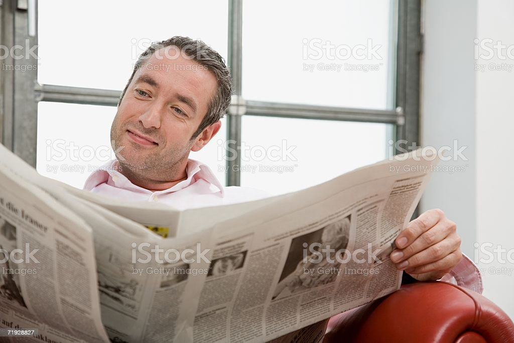 Man reading a newspaper royalty-free stock photo