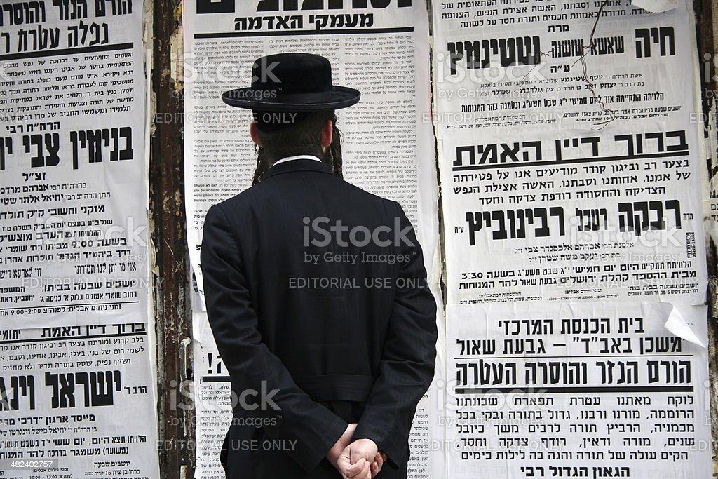 Man reading at Mea Shearim - Jerusalem stock photo