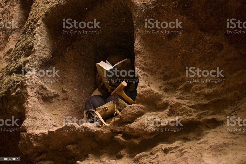 Man reading bible in Lalibela, Ethiopia stock photo