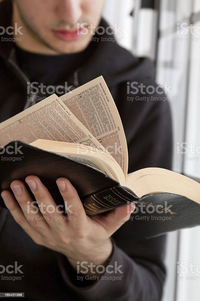 Man Reading Bible stock photo