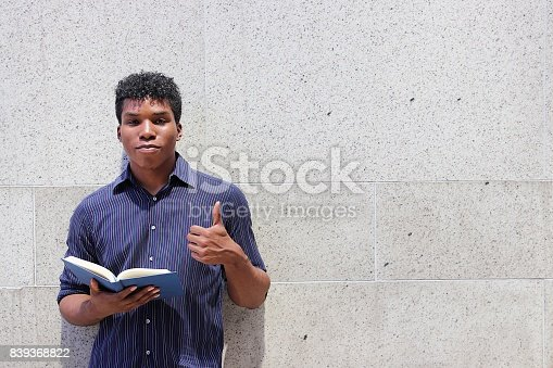 istock man reading book 839368822