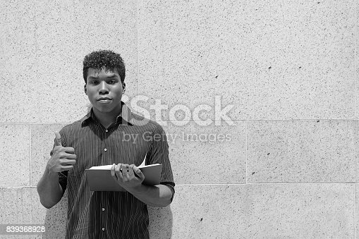 istock man reading book 839368928