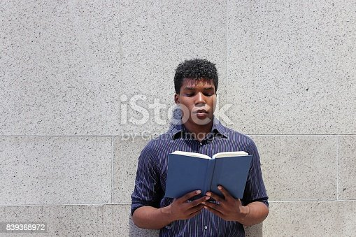 istock man reading book 839368972