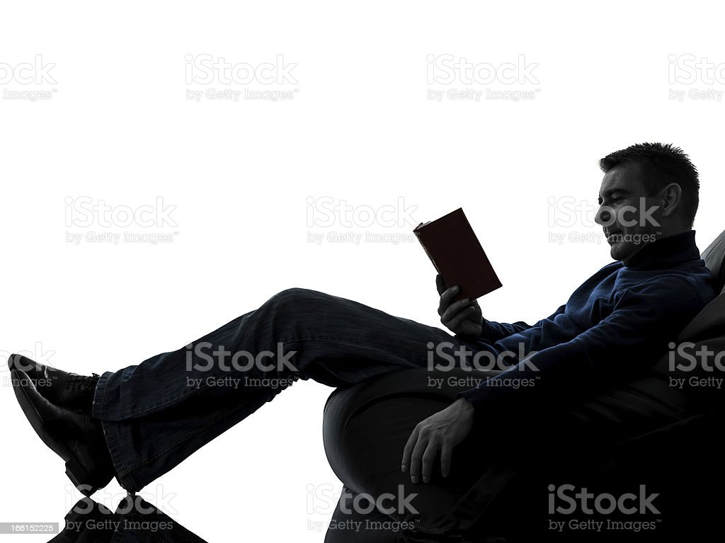 man reading book silhouette full length royalty-free stock photo