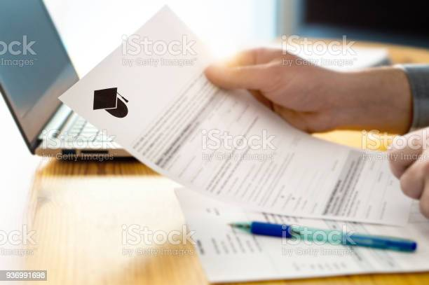 Man reading college or university application or document from school picture id936991698?b=1&k=6&m=936991698&s=612x612&h=1e0ep3ll9 vrnhuubpa nn8v cehy5udds2ictrgxzi=