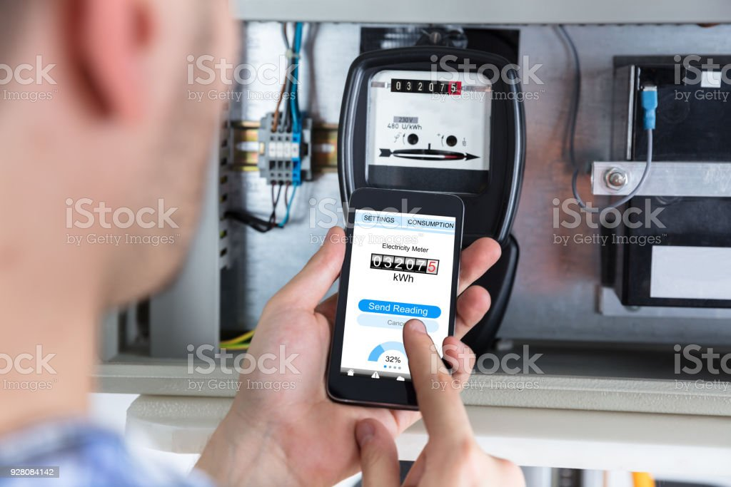Man Reading Electric Meter Stock Photo - Download Image Now ... on dwell meter, home generator, residential electrical meter, home power analyzer, electronic meter, home power rack, energy consumption meter, home power monitor, home power transformer, home depot meter cans, home electrical meter, generator transfer switch at meter, commercial electrical meter, science meter, home humidity meter, home voltage tester, home electrical fuse, home electricity meter, home energy meter, home power line,