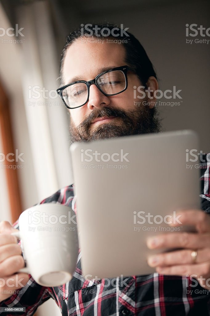 Man Reading Electronic Tablet stock photo