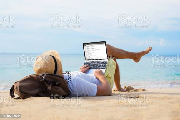 Man reading email on laptop while relaxing on beach picture id1049721644?b=1&k=6&m=1049721644&s=612x612&h=z1yjeeglibrupie0auytgsahr8ykmvux66ttftoqgzy=
