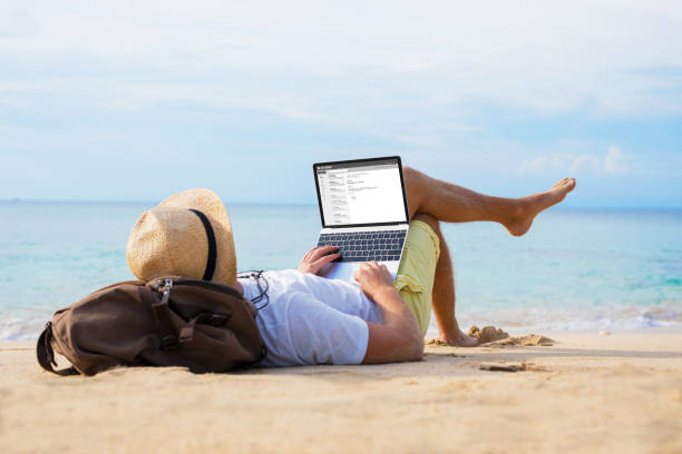 Man reading email on laptop while relaxing on beach picture id1049721644?b=1&k=6&m=1049721644&s=612x612&w=0&h=hhjdcgqcw ld7kwdyh59vjzn8derwkk93o6hi n7pqy=