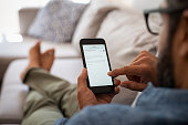 istock Man reading email on smartphone 1088347818