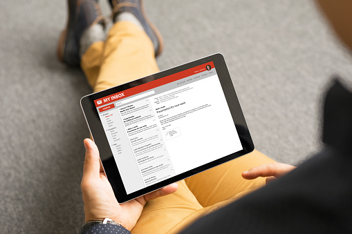 Man Reading Email On Tablet Stock Photo - Download Image Now