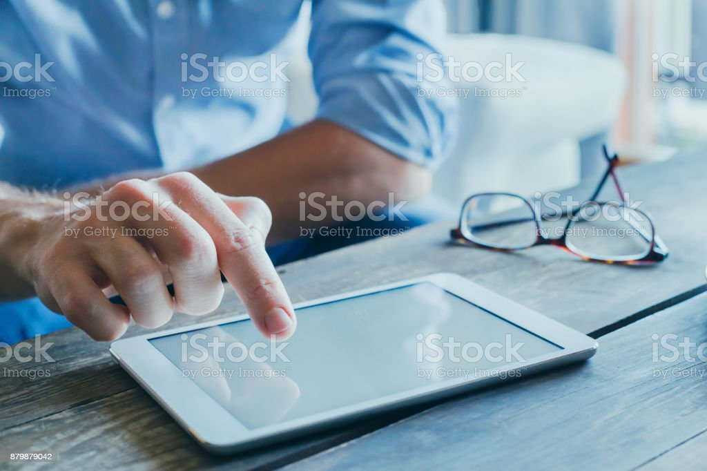 man reading emails and news on social media stock photo