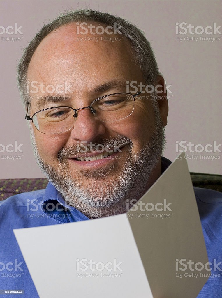 Man reading greeting card royalty-free stock photo