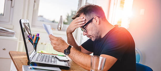 man reading letter and felling worried - porzellan druck stock-fotos und bilder