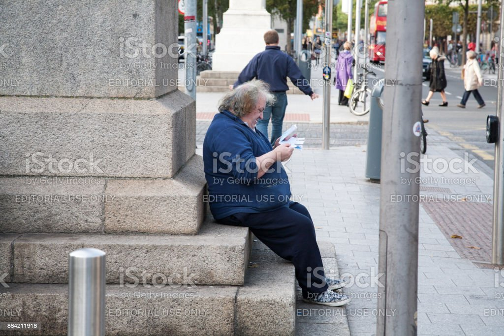 Man reading letter at O'Connell monument stock photo