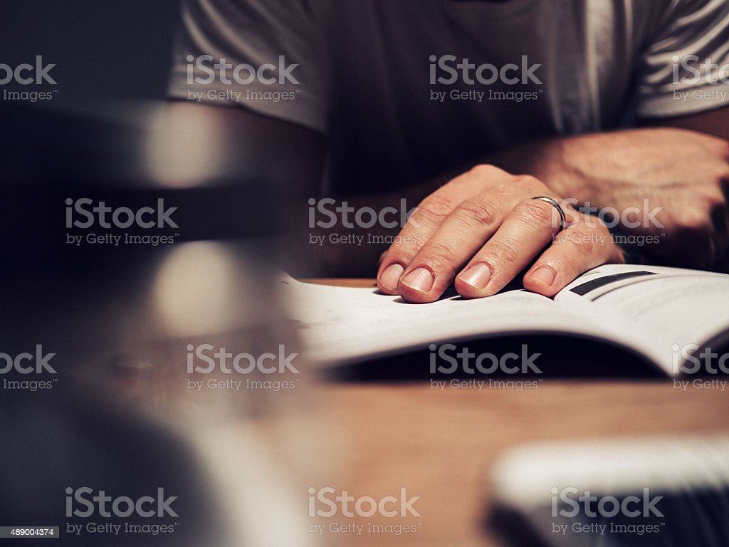 Man reading manual book stock photo