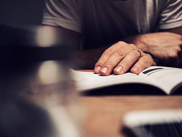 Man reading manual book stock photo