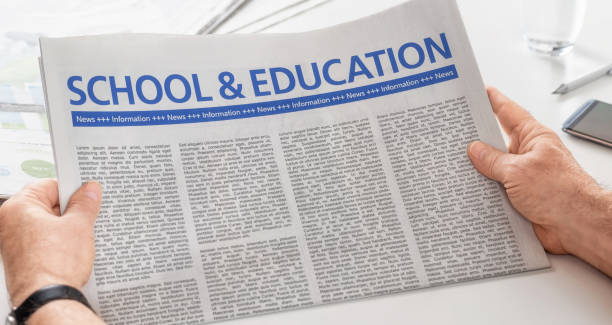 Man reading newspaper with the headline School and Education Man reading newspaper with the headline School and Education front page stock pictures, royalty-free photos & images