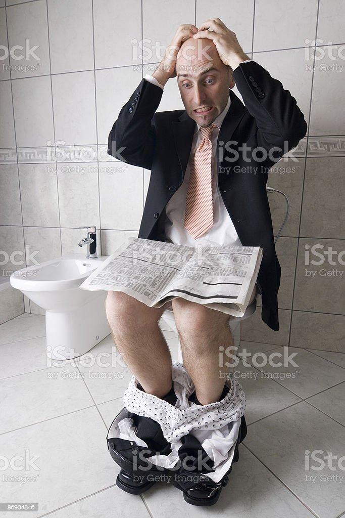 Man reading on toilet royalty-free stock photo
