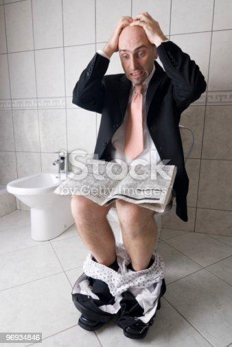 1130731761 istock photo Man reading on toilet 96934846