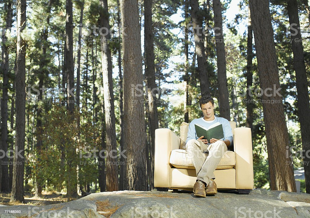 A man reading outdoors in the woods royalty-free stock photo