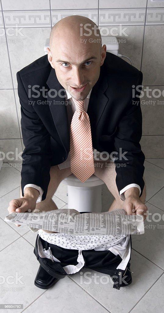 Man reading paper on toilet royalty-free stock photo