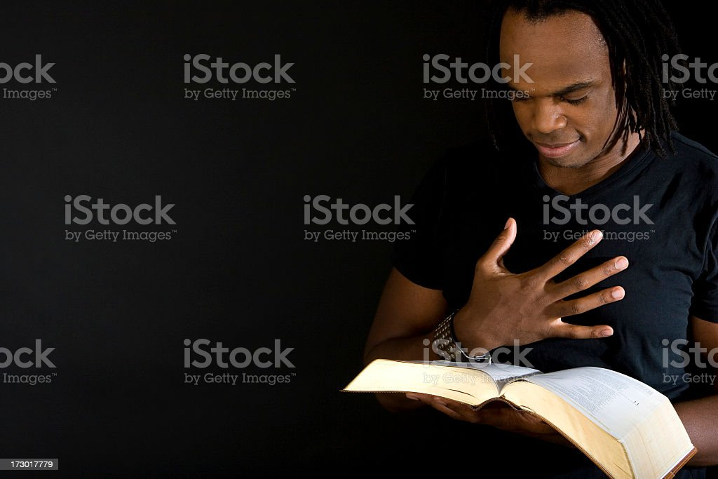Man reading the bible stock photo