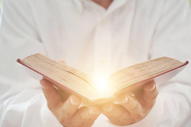 a man reading the holy bible. - preacher stock photos and pictures