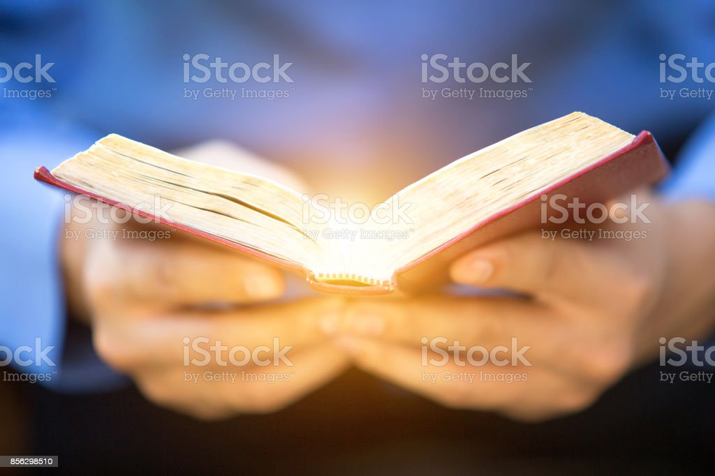 A man reading the Holy Bible. stock photo